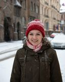 Portrait joyful young woman with blond hair having fun on street full with snow royalty free stock photo