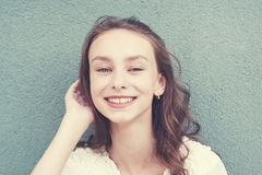 Cheerful beautiful girl with wavy hair royalty free stock photography