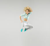 Portrait of a jumping blond athlete Royalty Free Stock Photography