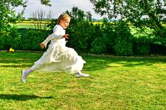 Portrait of a jumping young girl, religious celebration Royalty Free Stock Photography
