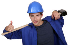 Portrait junior carpenter with hammer Stock Photos