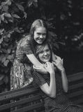 Portrait of  junior woman hugging adult sister at park Royalty Free Stock Photos