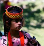 Portrait of Kalash tribe woman in national costume at Joshi fest Bumburet, Kunar, Pakistan. Portrait of Kalash tribe woman in national costume at Joshi fest - 14 stock image