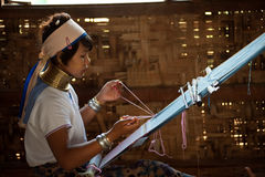 Portrait of Kayan Lahwi girl is weaving. Royalty Free Stock Images