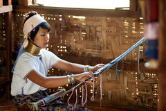 Portrait of Kayan Lahwi girl is weaving. Royalty Free Stock Photos