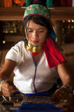 Portrait of Kayan Lahwi  girl is weaving. Royalty Free Stock Image
