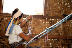 Portrait of Kayan Lahwi girl is weaving. Stock Images