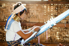 Portrait of Kayan Lahwi girl is weaving. Stock Photos