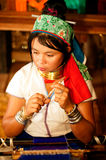 Portrait of Kayan Lahwi girl is weaving. Royalty Free Stock Photography