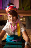 Portrait of Kayan Lahwi girl is weaving. Stock Photography