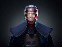 Portrait of kendo fighter. In traditional armor Royalty Free Stock Photo