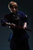 Portrait of a kendo fighter with bokken Royalty Free Stock Photo