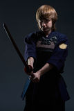 Portrait of a kendo fighter with bokken Royalty Free Stock Photography