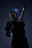 Portrait of a kendo fighter with shinai Royalty Free Stock Image