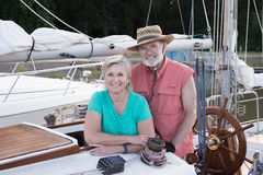 Portrait on the Ketch. Portrait of a happy retired couple on their classic ketch moored at their slip Stock Photos
