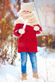 Portrait of kid with big icicles during winter walk Royalty Free Stock Photo