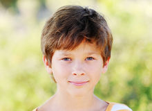 Portrait of kid boy outdoors. On nature background Royalty Free Stock Image