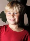 Portrait of kid boy in red shirt indoor Stock Images