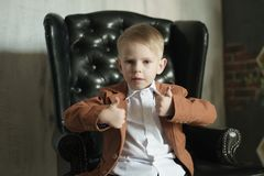 Portrait of a kid businessman on the modern background royalty free stock image
