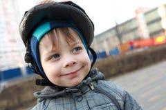 Kid with crash helmet Stock Images