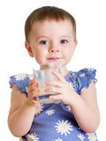 Portrait of kid drinking milk from glass. Portrait of child drinking milk from glass Royalty Free Stock Photo