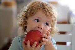 Portrait of kid eating apple Stock Photo