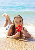 Portrait of kid girl on the beach Stock Images