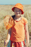 Portrait of kid girl with butterfly net Stock Photo