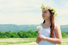 Portrait of kid girl with dandelion. Over sky Royalty Free Stock Photo