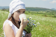 Portrait of kid girl drinking milk Royalty Free Stock Images