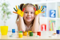 Portrait of kid girl with face and hands painted Stock Photos