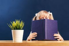 Pupil Girl with Book royalty free stock image