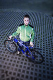 Portrait of kid standing with bike Stock Image