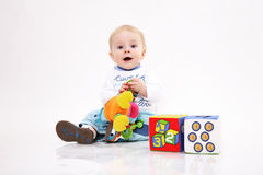 Portrait of the kid among toys Stock Images
