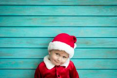 Portrait of kid wearing Santa Claus costume royalty free stock photo