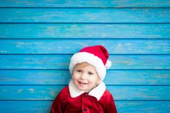 Portrait of kid wearing Santa Claus costume stock photo