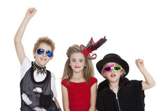 Portrait of kids fancy dress outfit with raised fist over white background Stock Photo