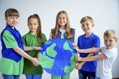 Kids with a globe. A portrait of kids with a globe Royalty Free Stock Photos