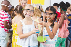 Portrait of kids holding laboratory flask in laboratory. At school Stock Photography