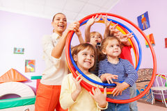 Portrait of kids with teacher looking though hoops Royalty Free Stock Images
