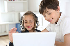 Children using internet and technology Royalty Free Stock Images