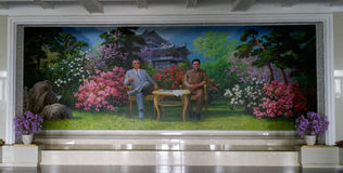 Portrait of Kim Il-sung and Kim Jong-Il (DPRK). Portrait of Kim Il-sung and Kim Jong-Il painted on the wall in some North Korean hotel lobby (Myohyang mountains Stock Photo