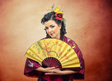 Portrait of kimono white mature woman with fan Royalty Free Stock Image