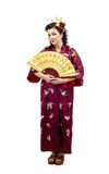 Portrait of kimono white woman with fan in full growth Royalty Free Stock Image