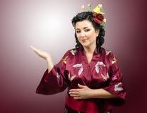 Portrait of kimono woman raised her right hand Stock Photo