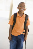 Portrait of kindergarten boy with backpack