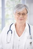 Portrait of kindly smiling female senior doctor Royalty Free Stock Photos