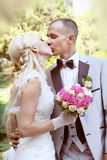 Portrait of kissing Bride and groom Stock Photography