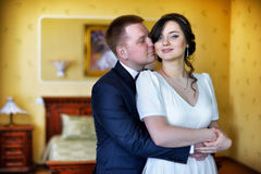Portrait of kissing Bride and groom Royalty Free Stock Image