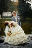 Portrait of kissing newlyweds royalty free stock photo